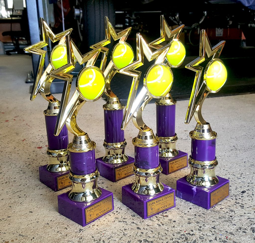 Purple and Gold Tennis Trophies